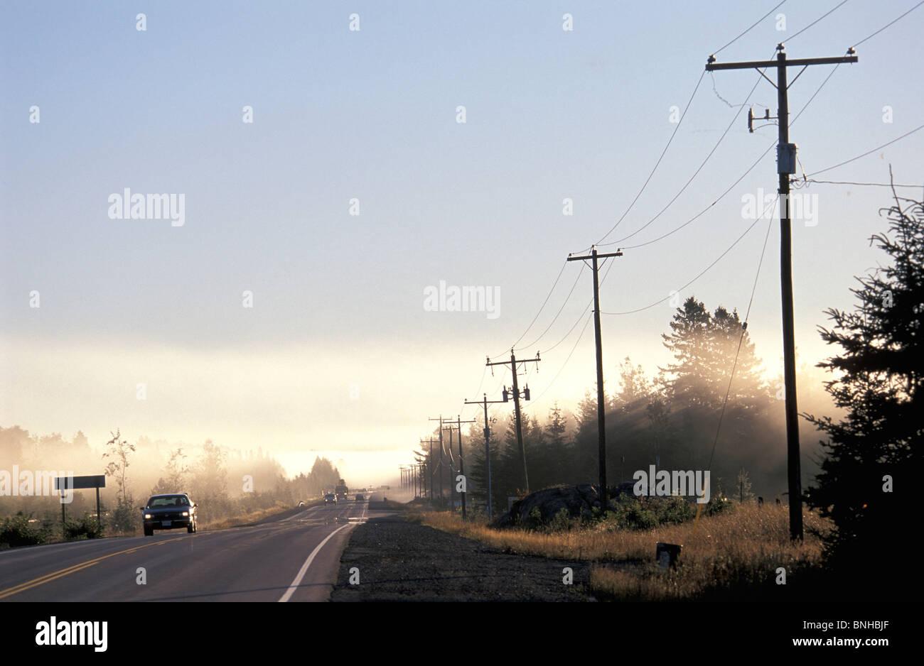Canada Espanola Ontario Highway 17 Near Espanola Country Road Power Lines Car Rural Foggy Landscape Scenery North - Stock Image