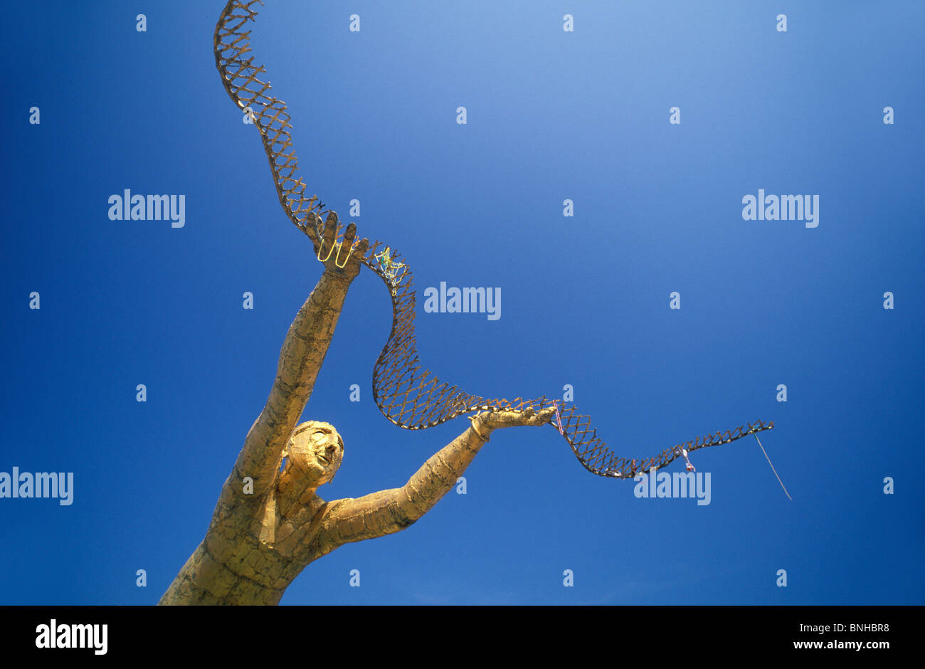 Usa Biloxi Mississippi Golden Fisherman Fisher Fishery Art Culture Blue Sky Sculpture Statue Net United States of Stock Photo