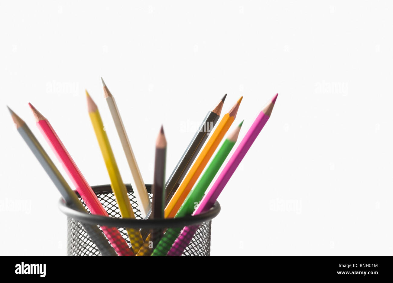 Close-up of colored pencils in a desk organizer - Stock Image