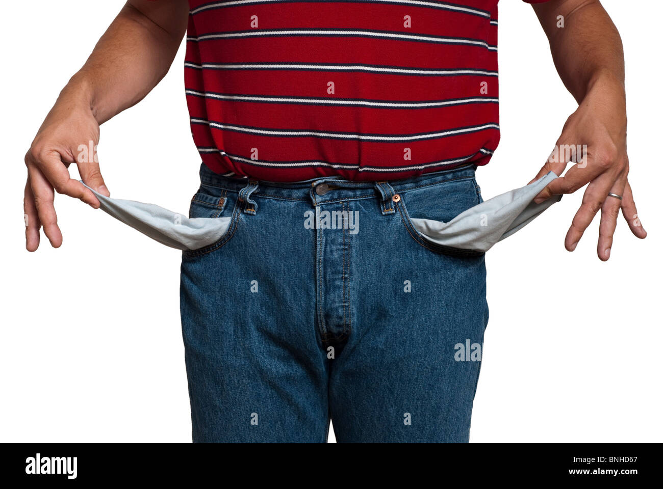 man in jeans, turning his pockets inside out to show he is poor. Isolated on white, saved with clipping path - Stock Image