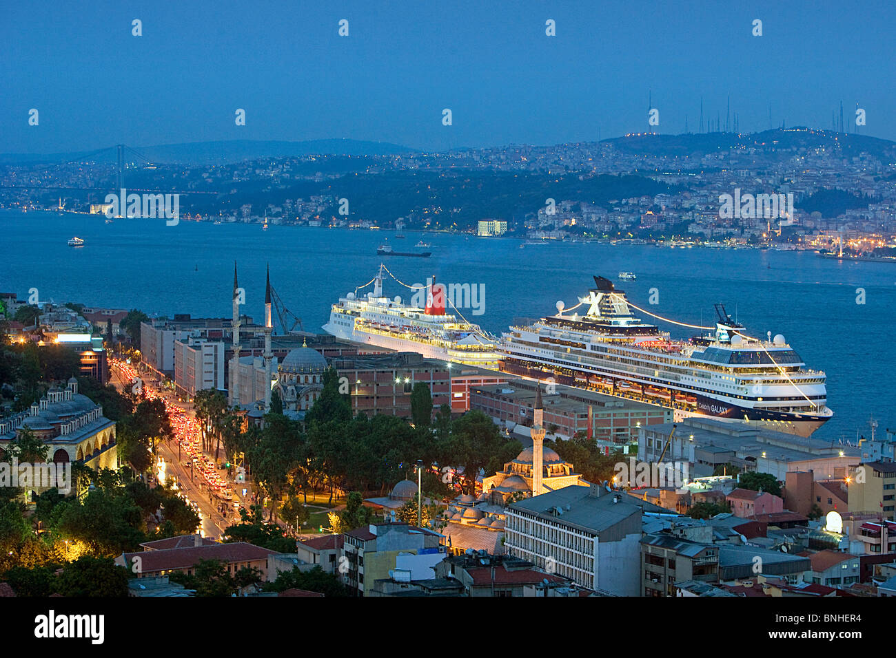 Turkey June 2008 Istanbul city Bosphorus Strait sea coast cruise ships ship port lights twilight dusk - Stock Image