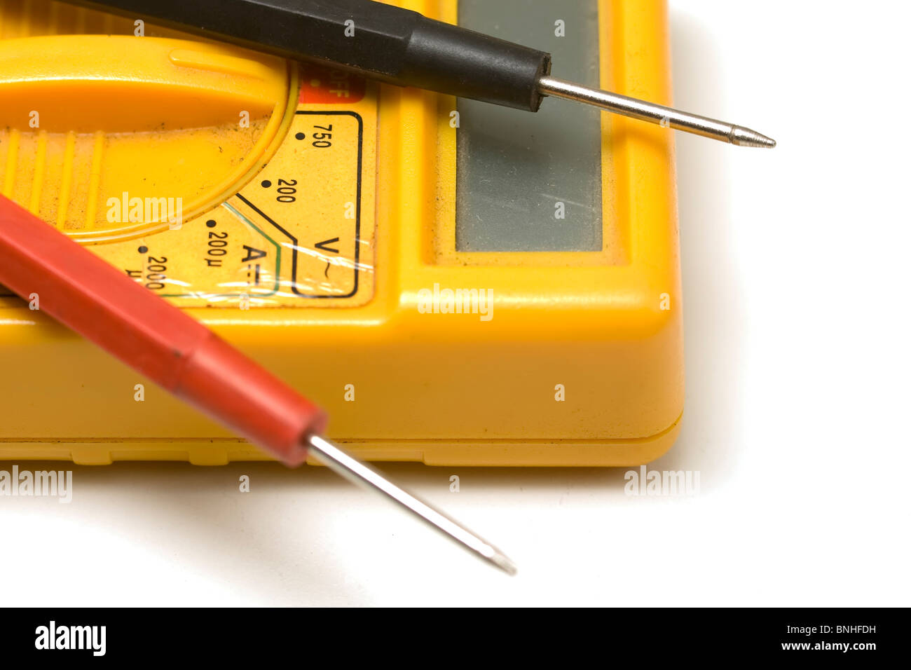 Yellow multimeter with testing needles - Stock Image