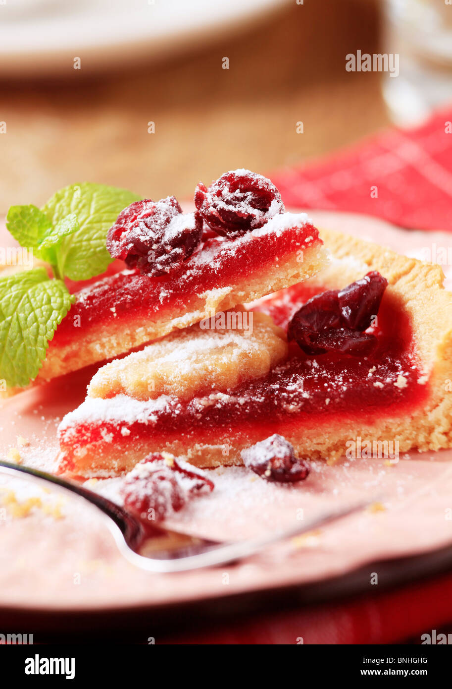 Slices of shortcrust cake with fruit filling - Stock Image
