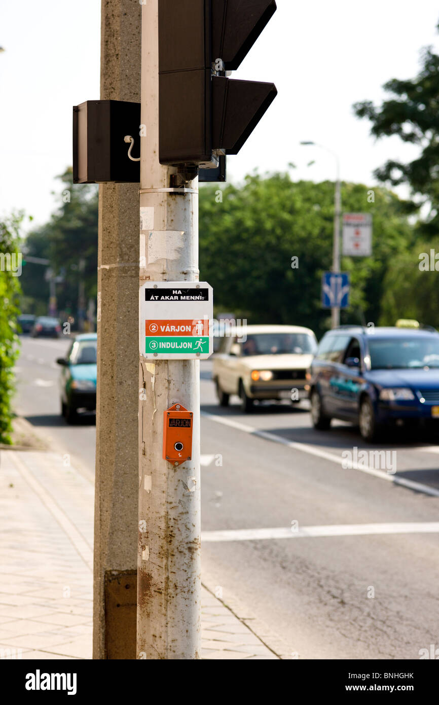 Crossing light request button for pedestrians blurred cars at back in Hajduszoboszlo Hungary - Stock Image
