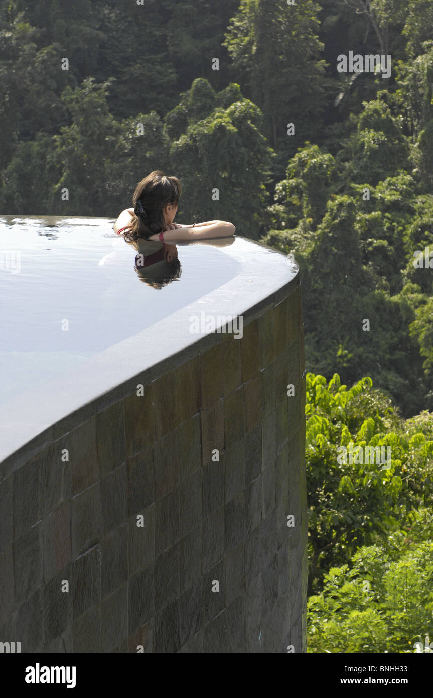 Bali Asia Indonesia travel Location Ubud Hotel Ubud Hanging Gardens pool one person swimming modern architecture - Stock Image
