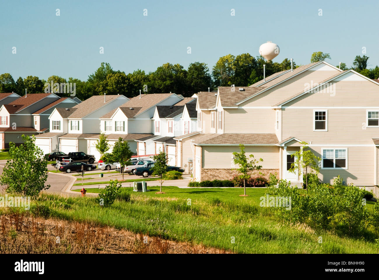 View of multiple family residences in a suburban neighborhood. - Stock Image