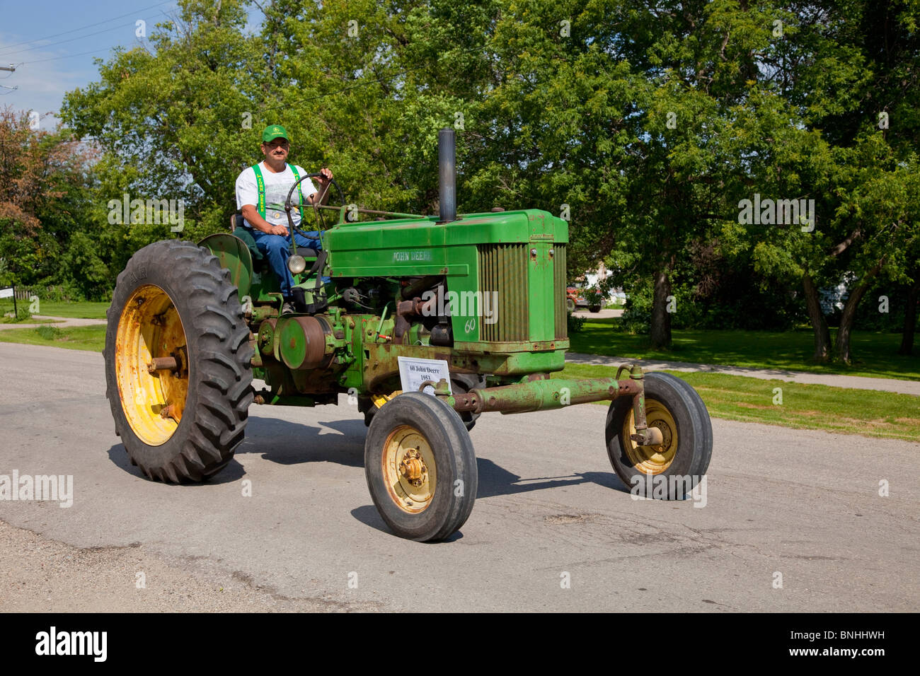 A procession of antique tractors at the 2010 Tractor Trek in Reinland, Manitoba, Canada. - Stock Image