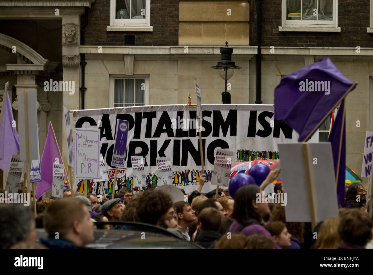 Fair Votes demonstration 'capitalism isn't working slogan'. Smith Square London during Liberal Democrat - Stock Image