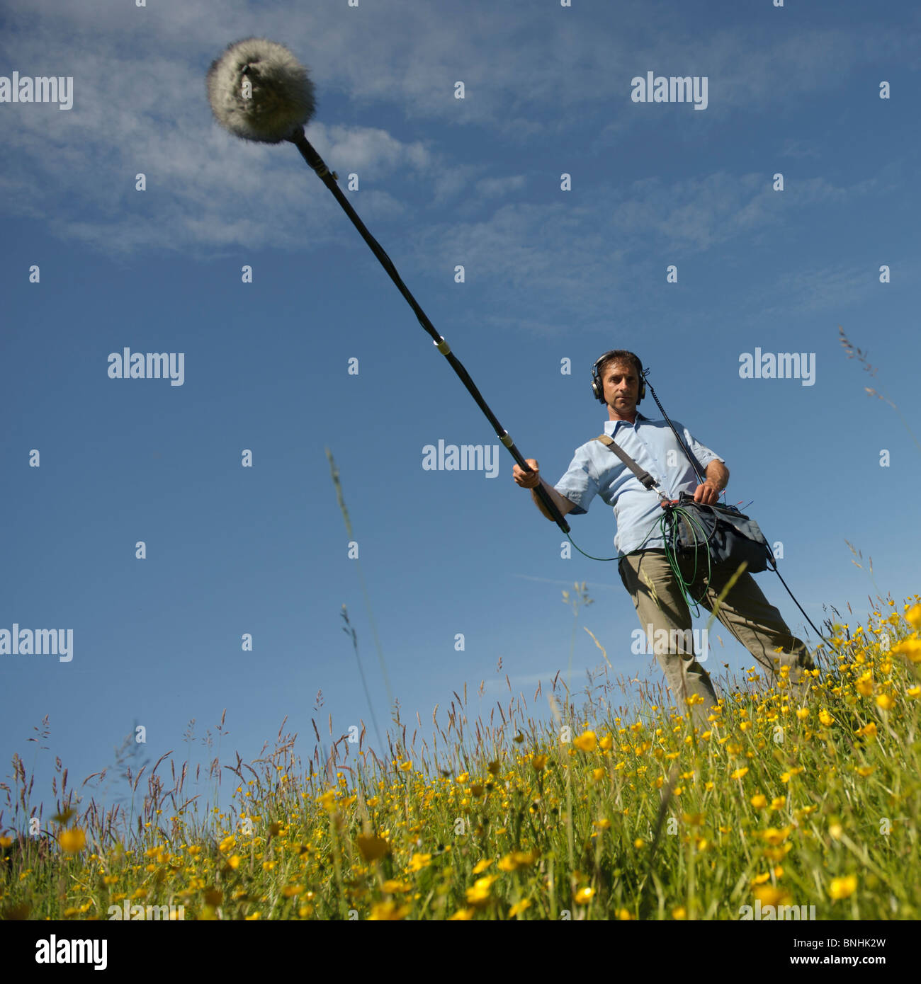 A sound recordist making recording for a nature natural history television programme, Wales UK - Stock Image