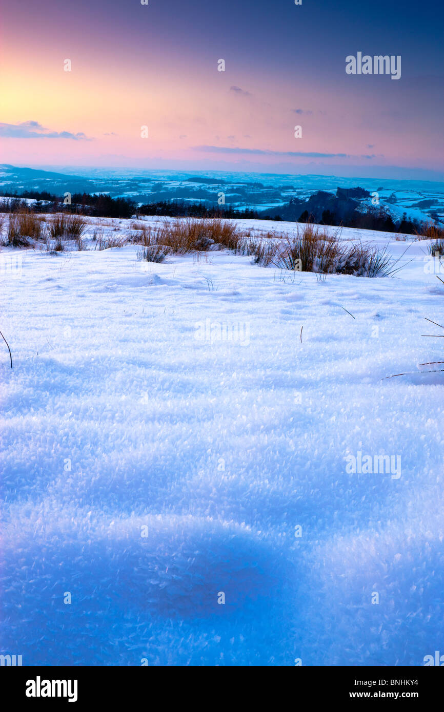 Snow fields on Black Mountain with views towards Carreg Cennen and Towy Valley Carmarthenshire Wales at sunset - Stock Image