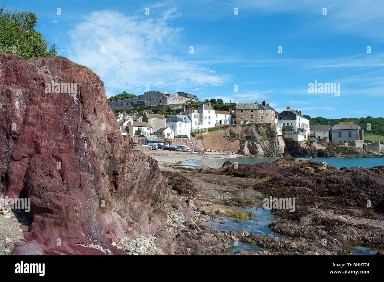 the red sandstone rock at cawsand in cornwall, uk - Stock Image