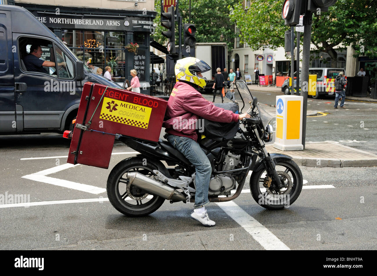 Medical Courier on moterbike carrying urgent blood Stock Photo