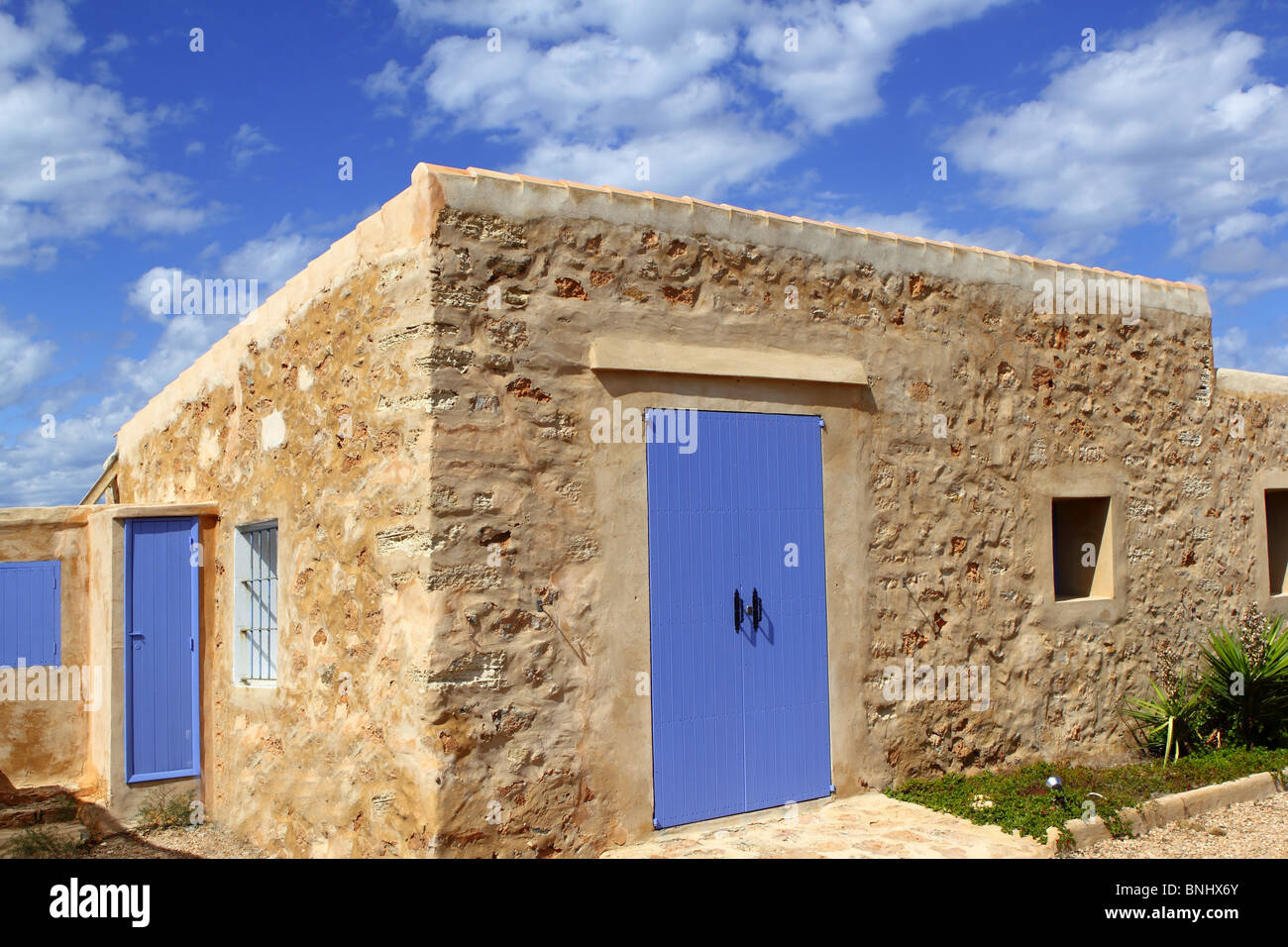 stone house masonry blue sky door windows Formentera Balearic - Stock Image