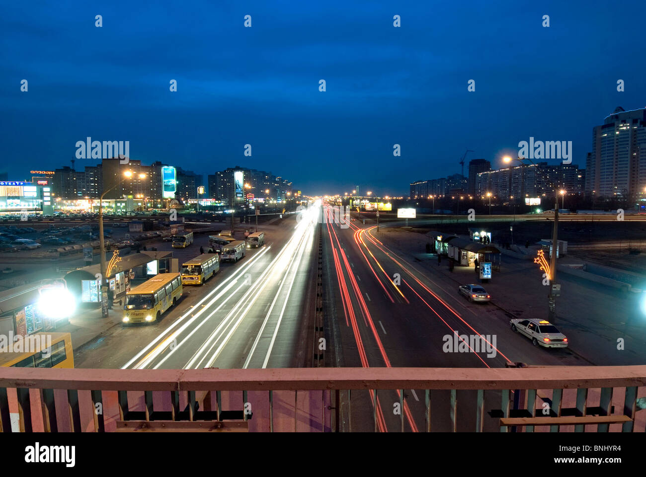 The Ukraine Kiev city Pozniaky periphery E40 highway traffic streets street bridge lights houses dusk night - Stock Image
