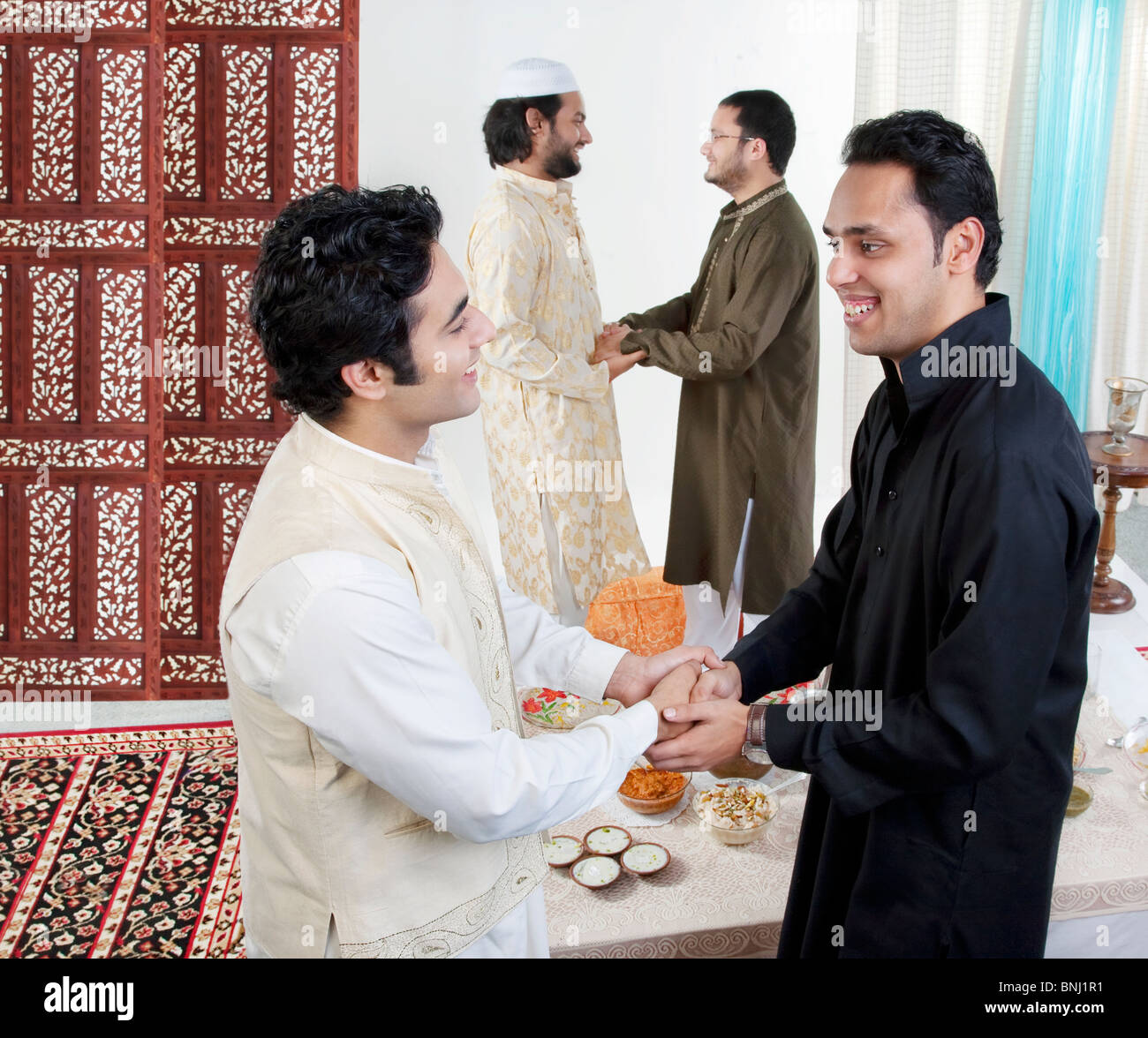 Muslims greeting other stock photos muslims greeting other stock muslim men greeting each other stock image m4hsunfo