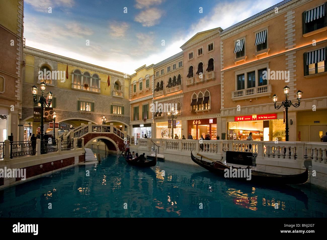 China Macao Macau city Venetian casino casino Venice simulation canal channel bridge gondolas - Stock Image