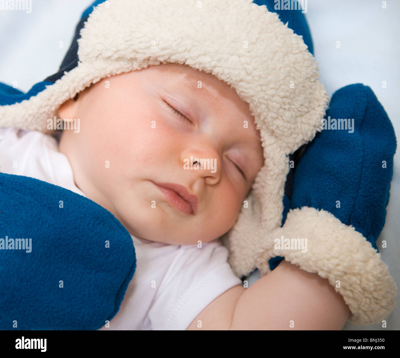 Beautiful 4 month old baby in hat sleeping Stock Photo  30515772 - Alamy 3743bf04494