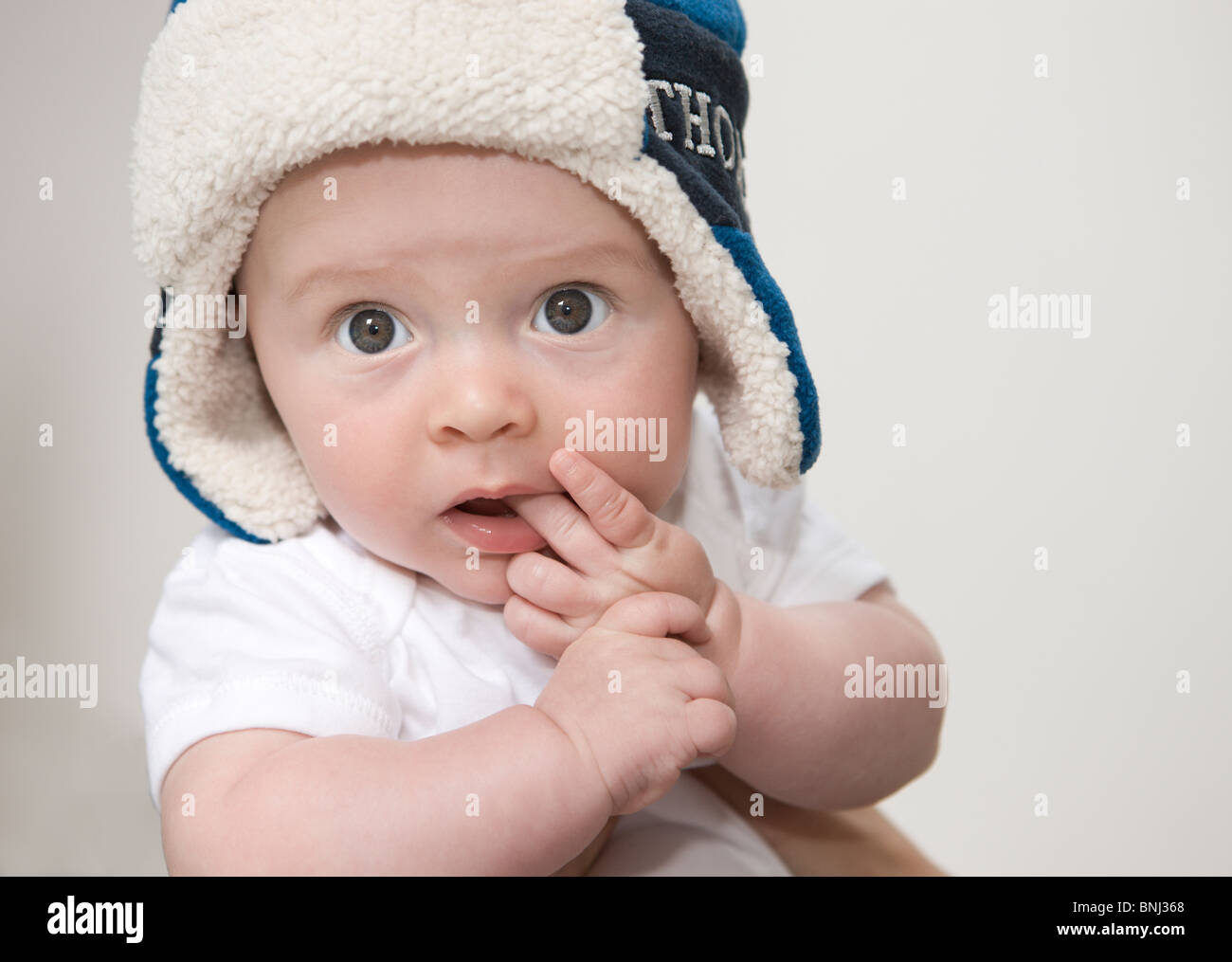Beautiful 4 month old baby wearing hat with a curious expression ... d2fa3a46fc6