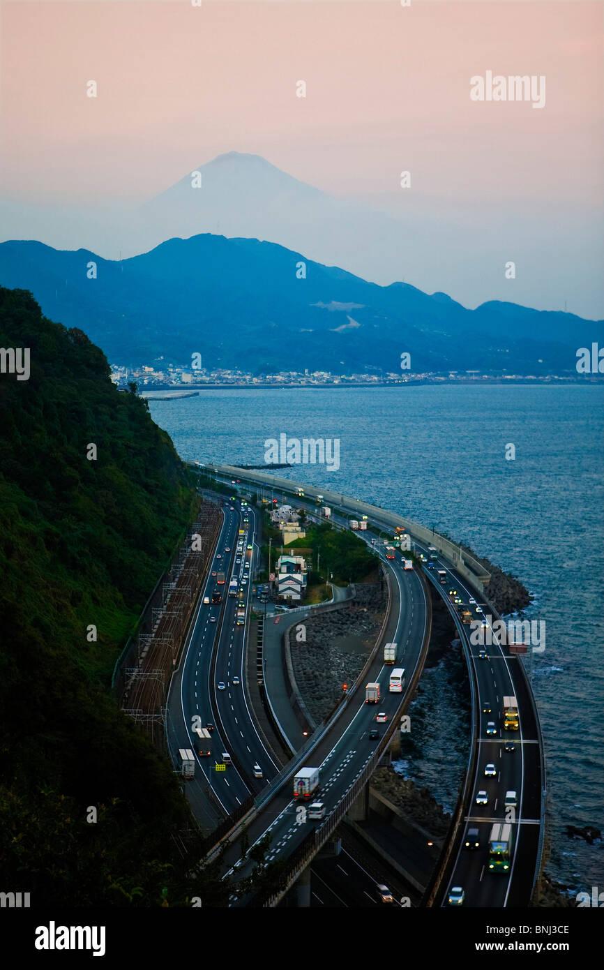 Japan Asia Tomei highway Mount Fuji Fujiyama Fuji Fujisan mountain evening twilight sea lights - Stock Image