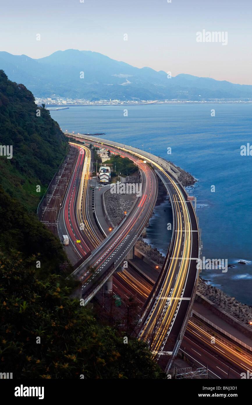 Japan Asia Tomei highway Mount Fuji Fujiyama Fuji Fujisan mountain evening twilight sea lights Stock Photo