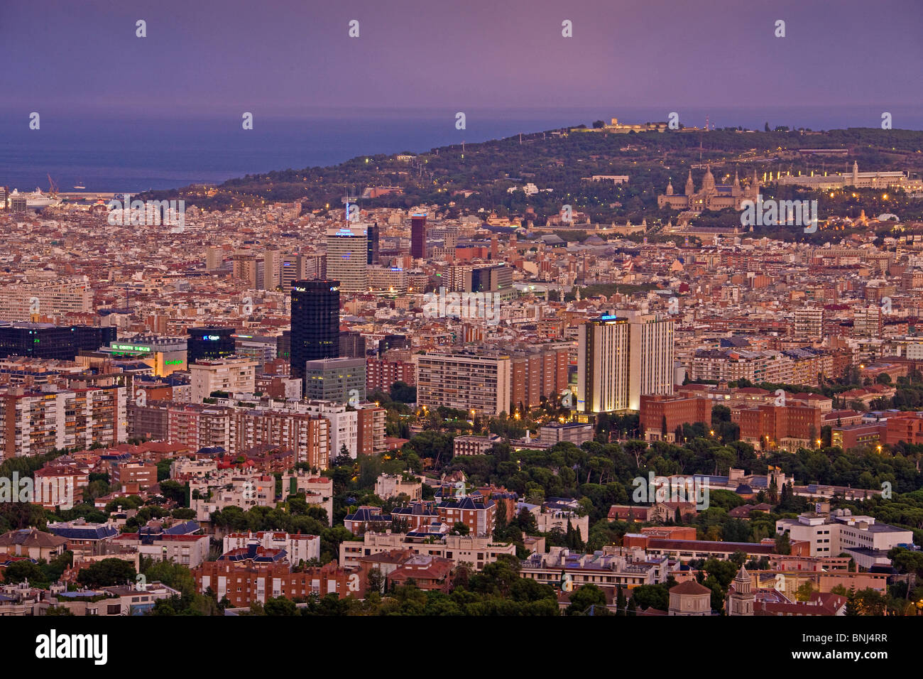 Spain Barcelona town city evening houses homes overview capital - Stock Image