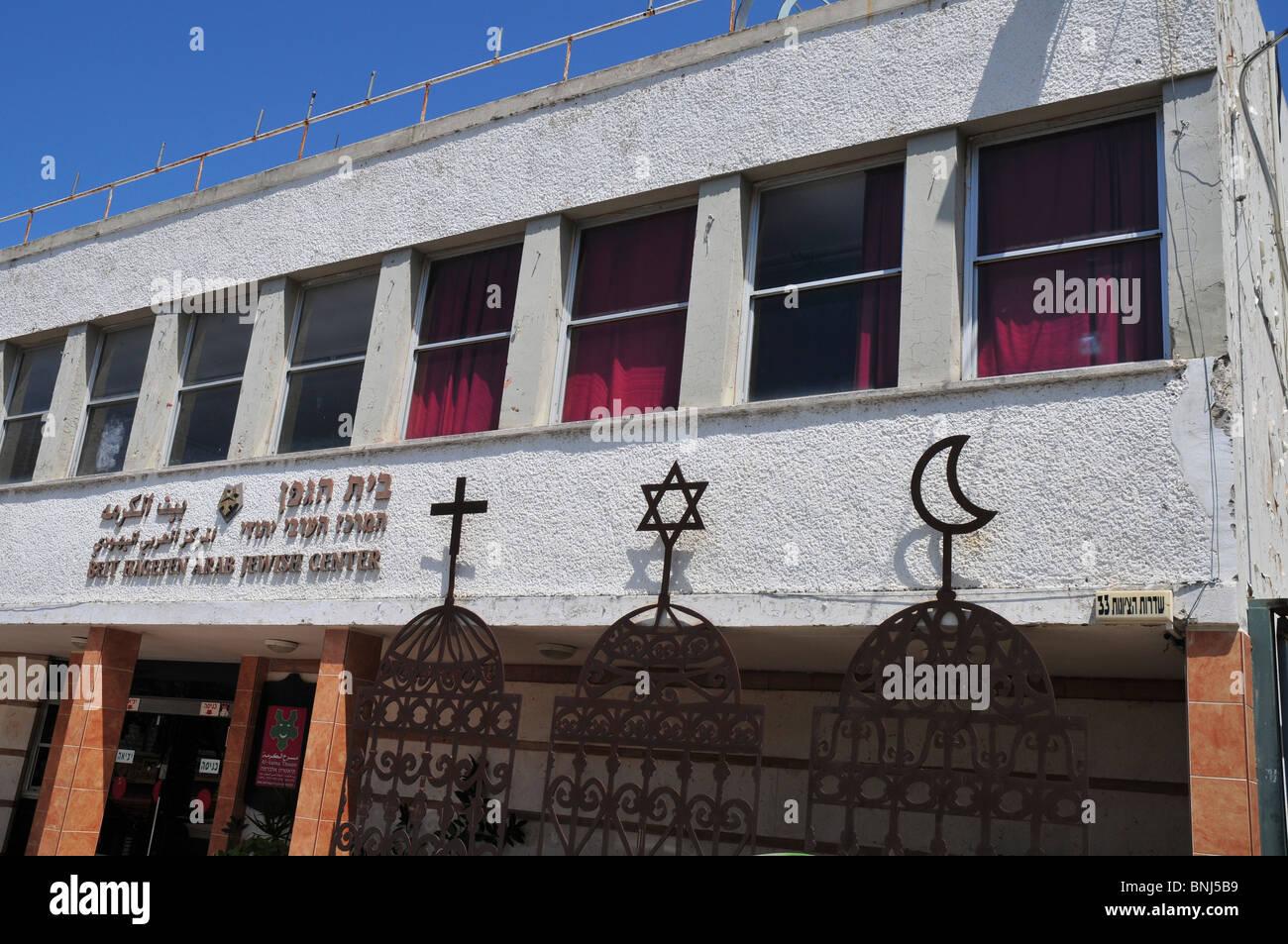 Israel, Haifa, The signs of the three major religions, Christianity, Judaism and Islam at Beit Hagefen Arab, Jewish - Stock Image