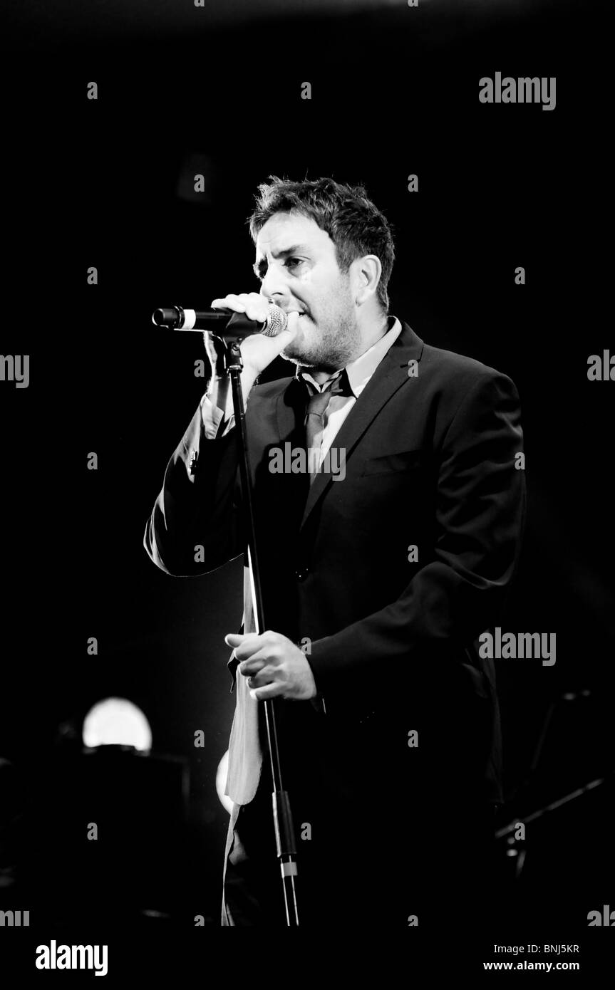 Terry Hall lead singer of The Specials on stage at Wolverhampton Civic Hall with  spotlight behind him Stock Photo