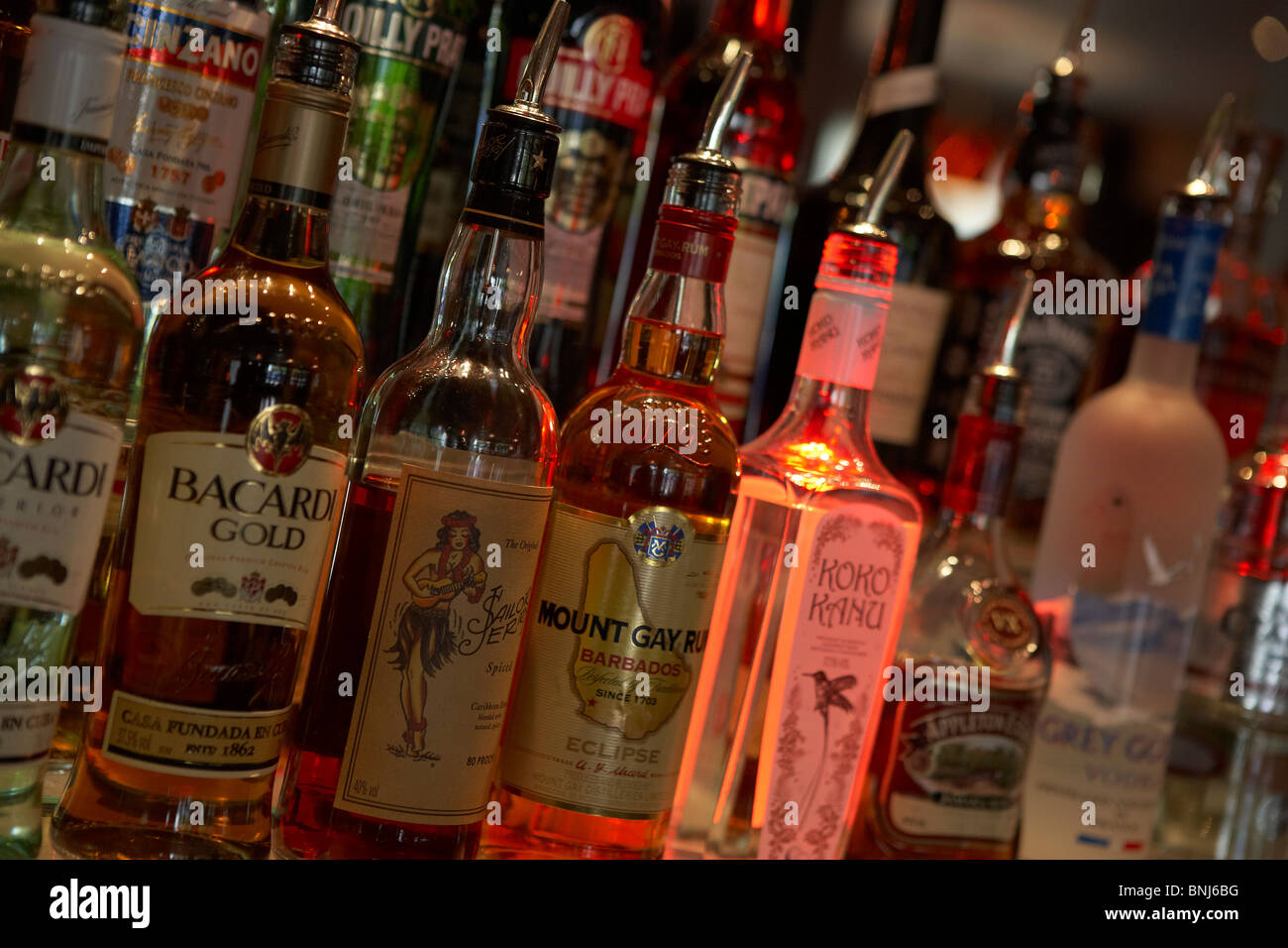BOTTLES OF SPIRITS IN COCKTAIL BAR - Stock Image
