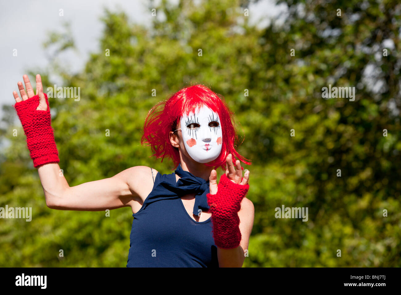 A female dancer / mime artist at a summer music festival - Stock Image