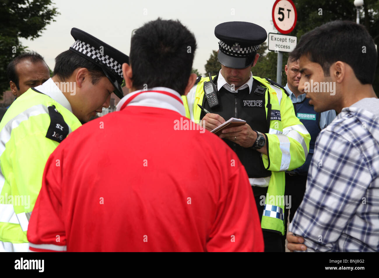 a police sting operation in Barnet, North London. The police are stopping cars and searching them in order to find - Stock Image