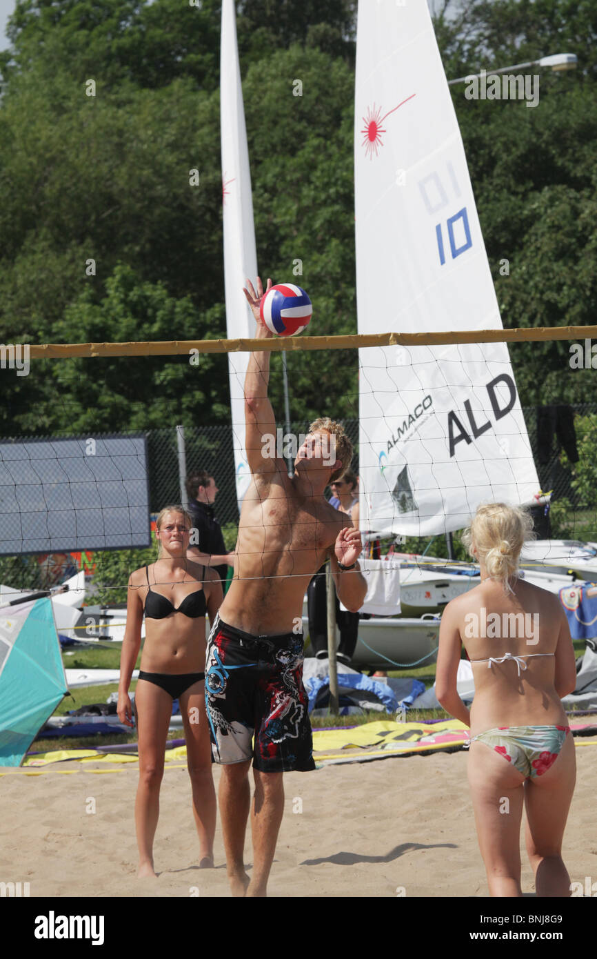 Sailors and fans play beach volleyball NatWest Island Games 2009 Eastern Harbour of Mariehamn on Åland, July 2 2009 Stock Photo