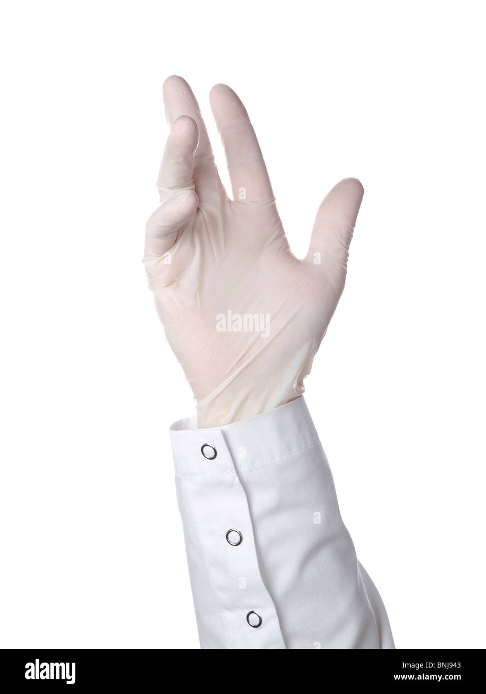 A doctor is wearing a latex glove. - Stock Image
