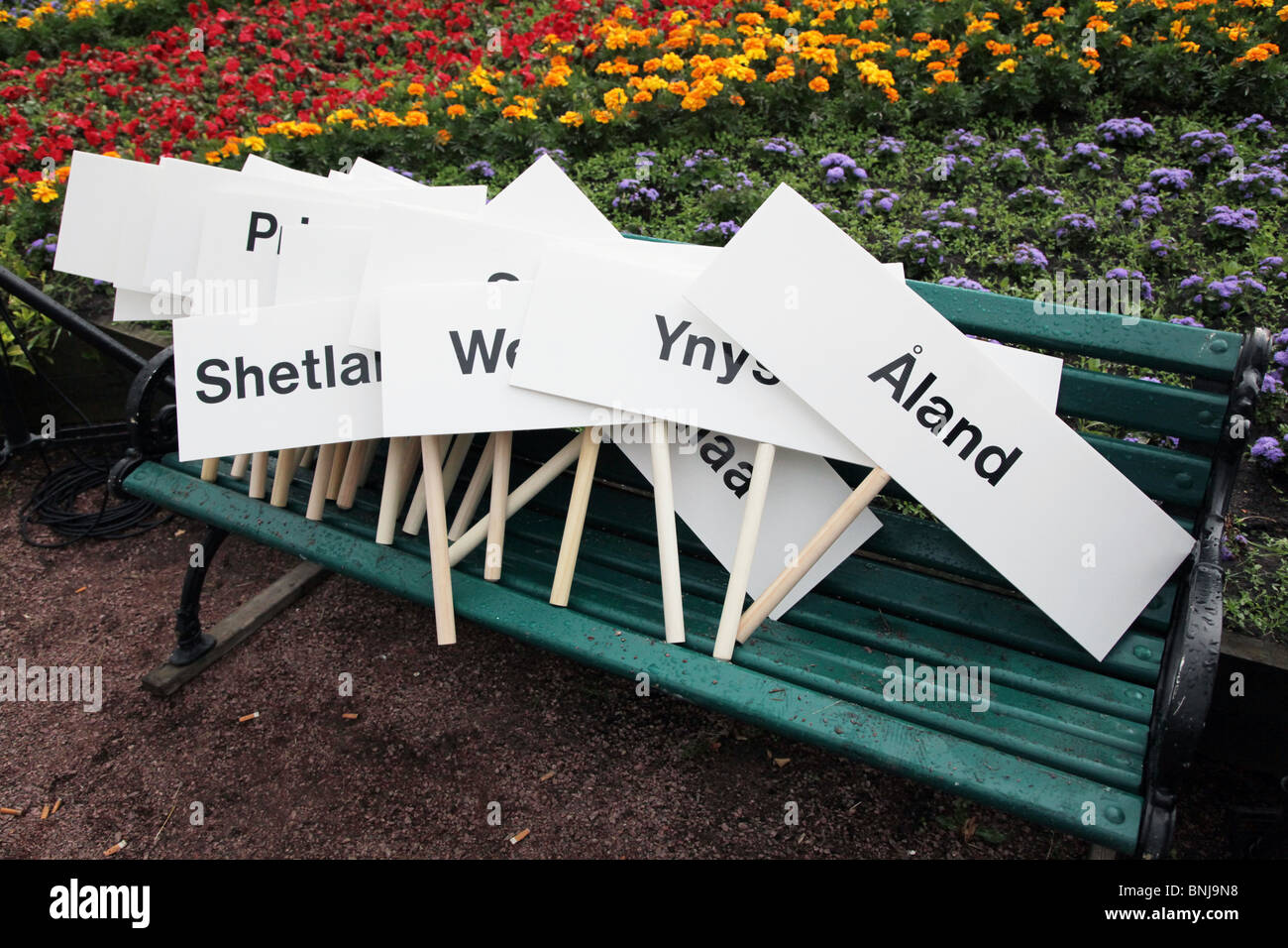 A symbolic pile of island plackards at Closing Ceremony NatWest Island Games 2009 in Mariehamn on Åland, July - Stock Image