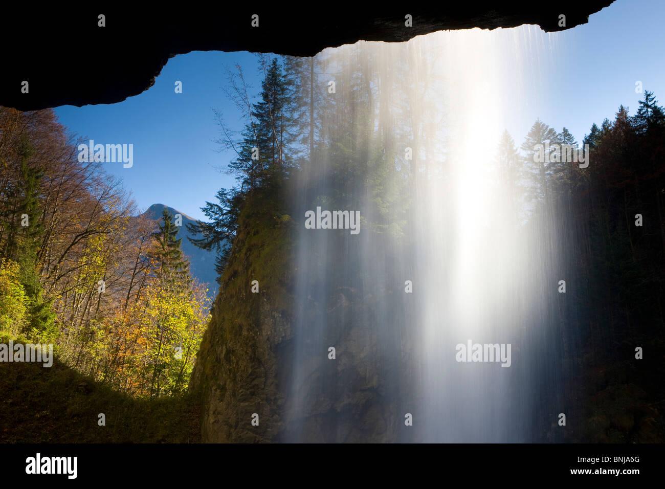 Berglistüber Switzerland Canton of Glarus waterfall brook creek wood forest autumn fall water curtain rock - Stock Image
