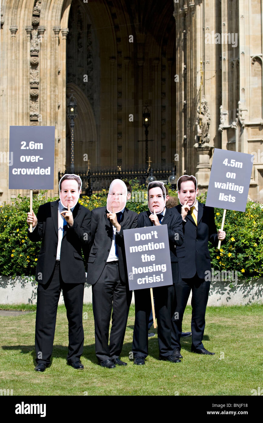Masked protesters outside British Parliament at Westminster, London, UK - Stock Image
