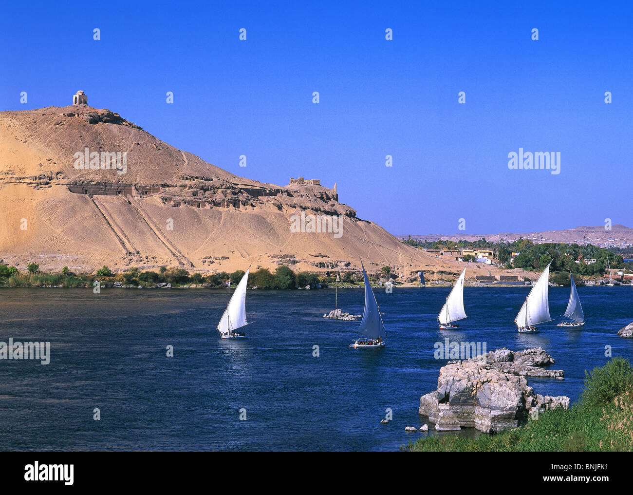 Egypt March 2007 Nile River at Aswan city Feluca boats landscape - Stock Image