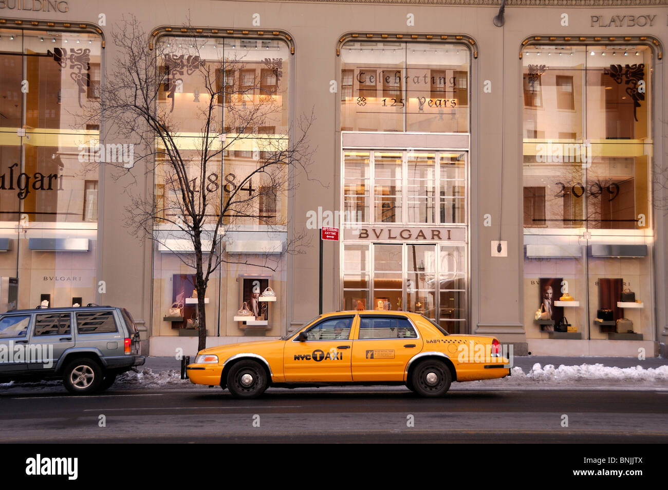 BVLGARI Bulgari 57th Street 5th Avenue Midtown Manhattan New York USA taxi. Yellow shopping city travel american - Stock Image
