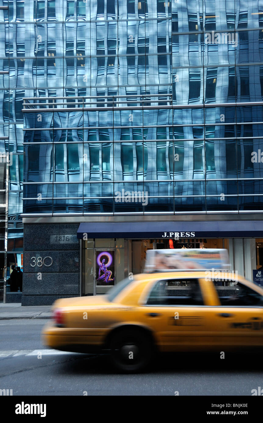 Building 380 Madison Avenue Midtown Manhattan New York USA architecture glass taxi cab yellow city travel american - Stock Image