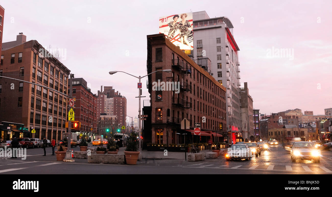 9th Avenue with The Gansevoort Hotel Meatpacking District Manhattan New York USA street lights traffic city travel - Stock Image