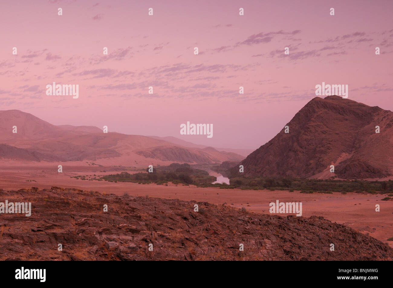 Colorful sky sunset Kunene River Serra Cafema Wilderness Safaris Kunene River Kunene Region Namibia Africa Travel - Stock Image