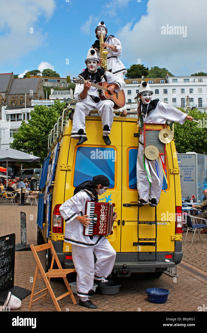 Pierrot Troupe of entertainers the Pier Echoes perform music song and dance on the Torbay sea front at Torquay - Stock Image