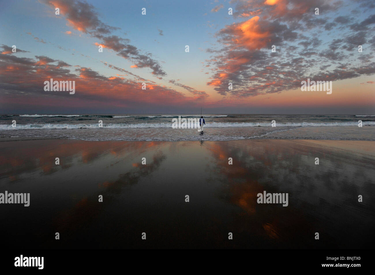 Fishing the Australian coast at sunset - Stock Image