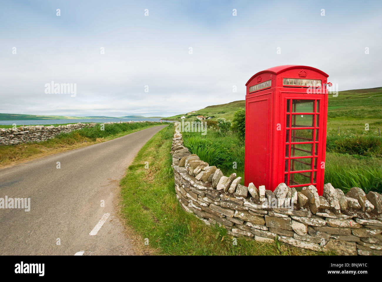 A typical British red telephone booth on the small isle of Rousay, Orkney. - Stock Image