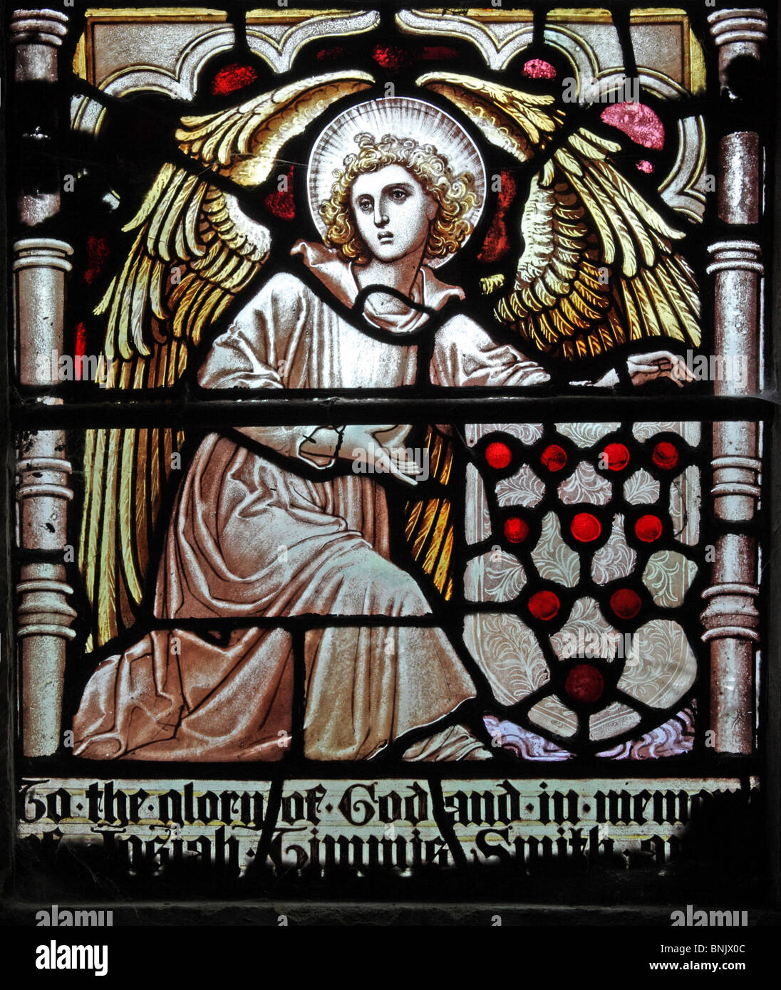 A stained glass window depicting an angel holding the Shield of the Diocese of Worcester - Stock Image