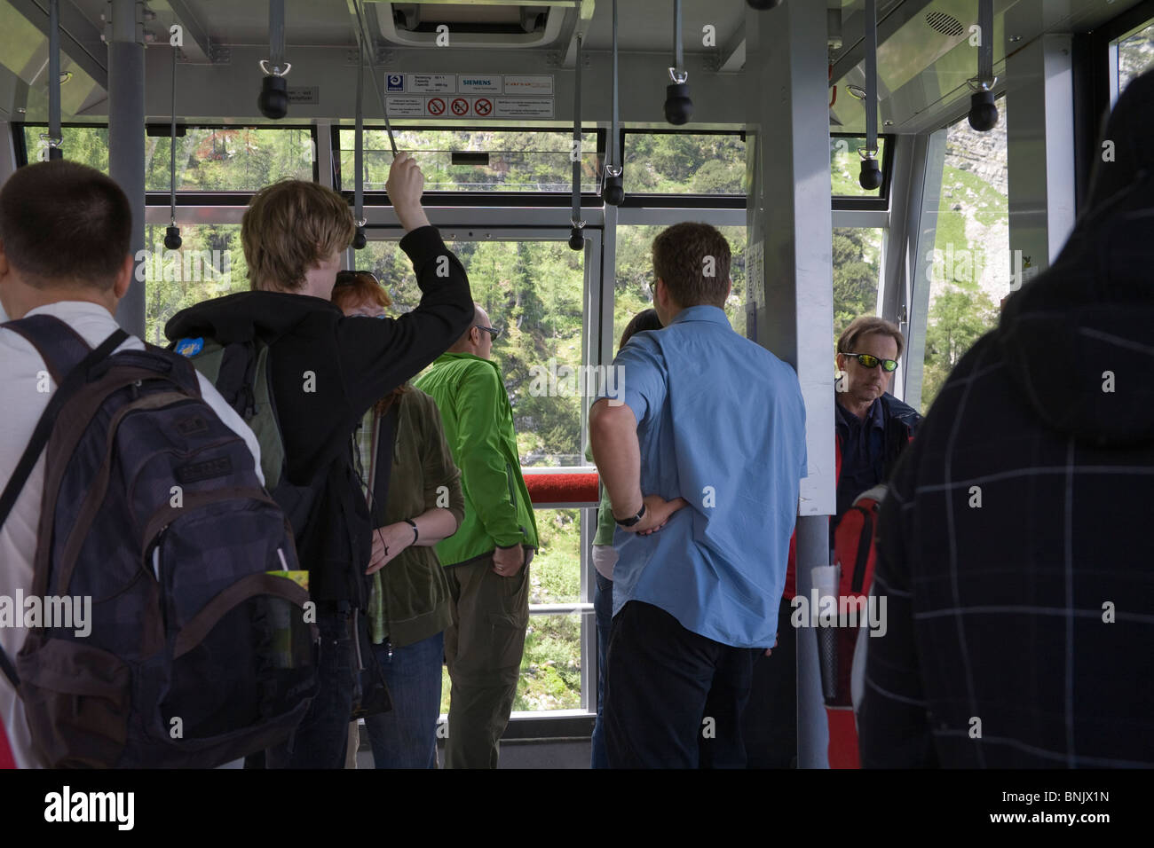 Austria Europe EU Travellers in a cabin of Dachstein World Heritage Cableways - Stock Image