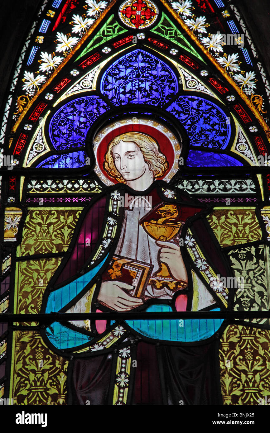 A stained glass window depicting Saint John the Evangelist with Poisoned Chalice - Stock Image