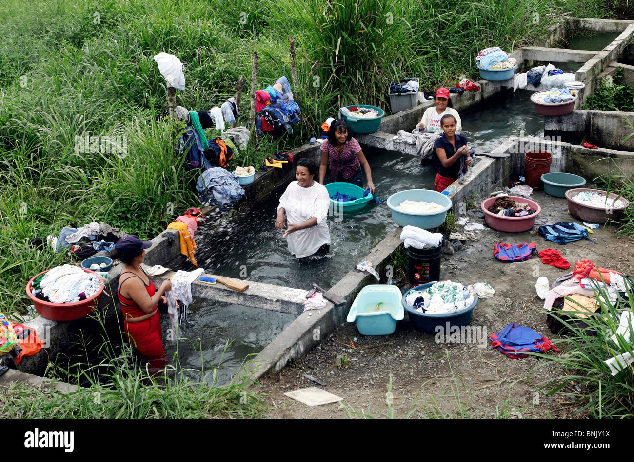 Women washing laundry in a small river in Ecuador, South America on Sept. 3, 2005. - Stock Image