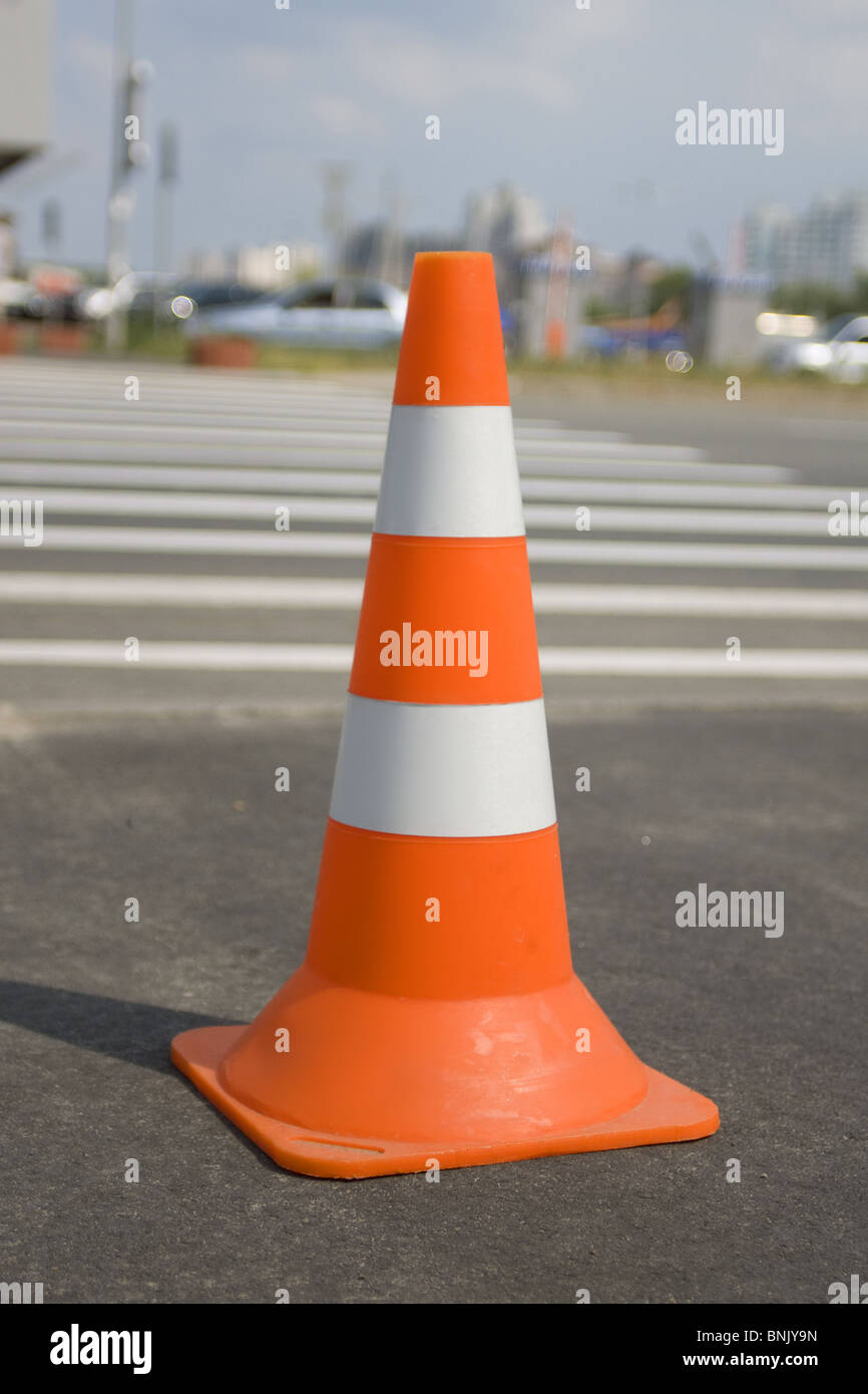 Close up of one traffic cone on a road with path - Stock Image