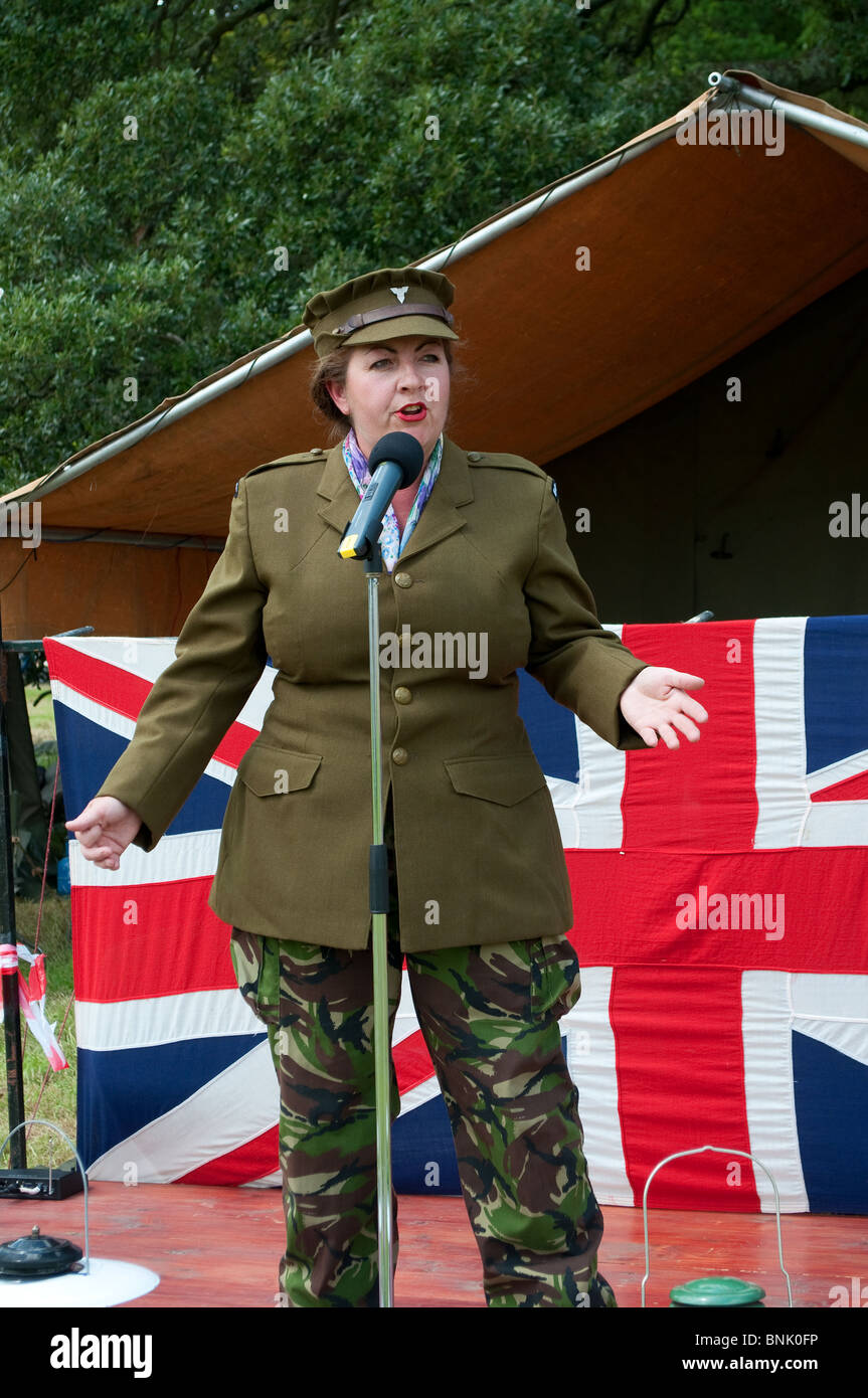 a female entertainer at a second world war re-enactment day in cornwall, uk - Stock Image