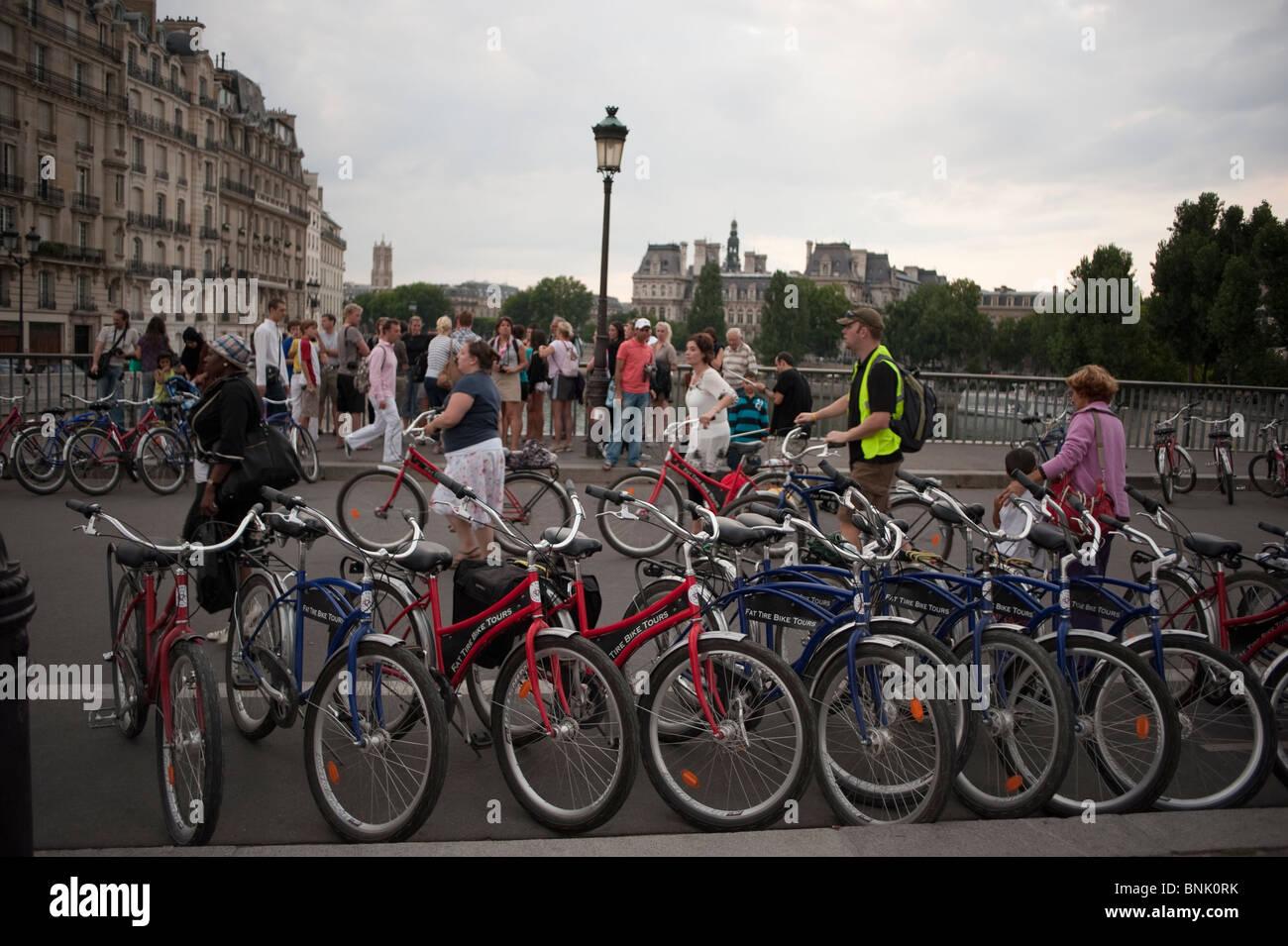 Paris, France, Group Bicycle Tour, Adult Tourists Visiting on 'Pont Saint Louis' Bridge, (Ile Saint Louis) - Stock Image